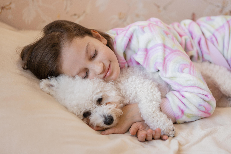 girl-hugging-her-dog-bed-while-sleepin