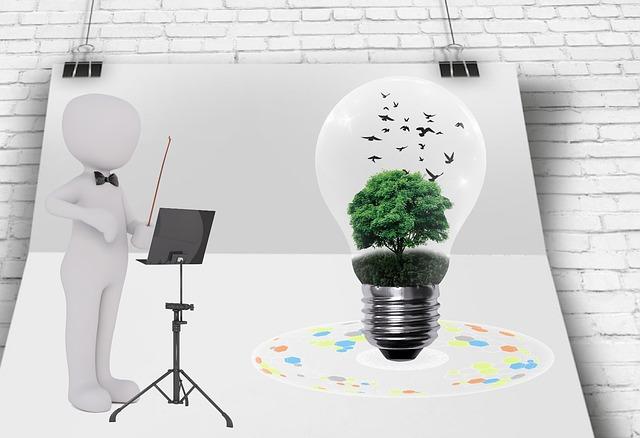 Obrázok s panáčikom, ktorý ukazuje na žiarovku, v ktorej je zelený strom a vtáky.jpg